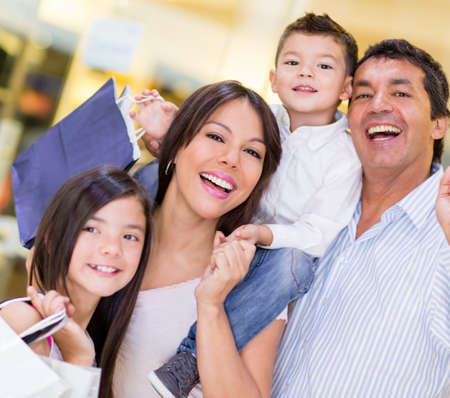 shoppers: Very happy family shopping and holding bags