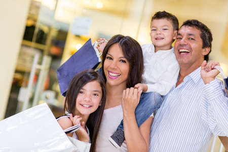 Family going shopping and looking very happy photo