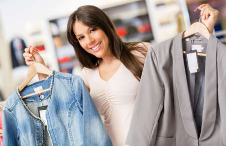 Happy shopping woman buying clothes at a store Stock Photo - 18782133