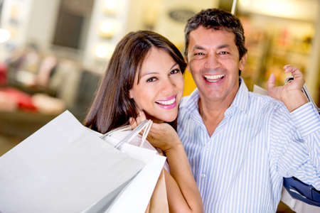 Shopping couple smiling and looking very happy Stock Photo - 18837644