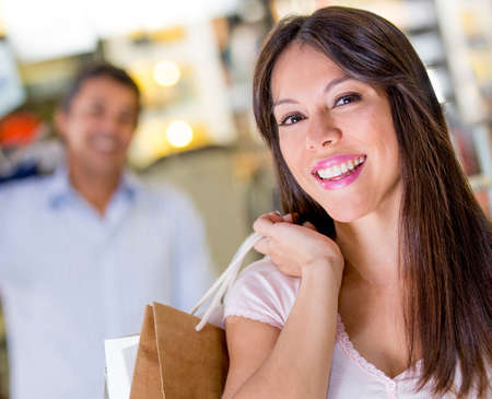 Happy woman shopping holding bags and smiling Stock Photo - 18837655