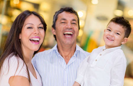 latin child: Happy family portrait at a shopping center Stock Photo