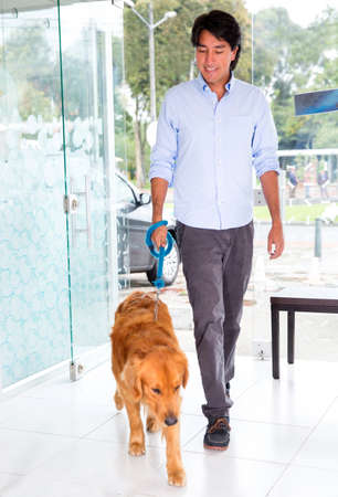 pet store: Man taking his cute dog to the vet Stock Photo