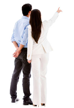 Business people pointing away - isolated over a white background photo