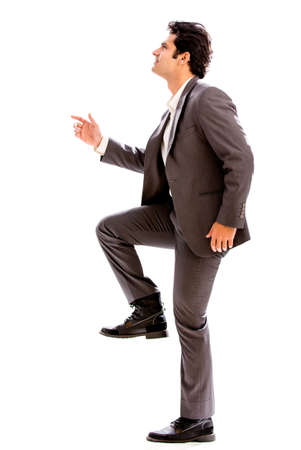 Business man stepping up - isolated over a white background photo