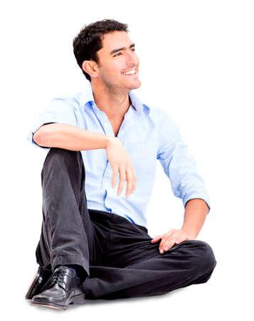 ülő: Pihentető üzletember ült a padlón, és mosolyogva -, elszigetelt, felett, fehér