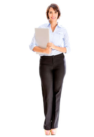 Successful business woman holding a laptop - isolated over white Stock Photo - 18811054