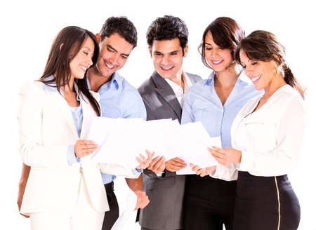 Successful business team looking at documents - isolated over white photo
