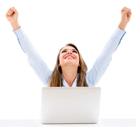 Successful business woman with laptop and arms up - isolated over a white background Stock Photo - 18904707
