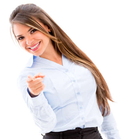 Confident business woman pointing to the camera - isolated over white photo