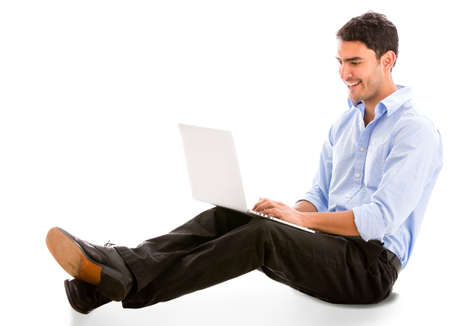 Relaxed business man working on a laptop - isolated over white Stock Photo - 18843632