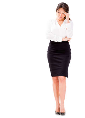 preoccupied: Business woman looking very worried - isolated over white