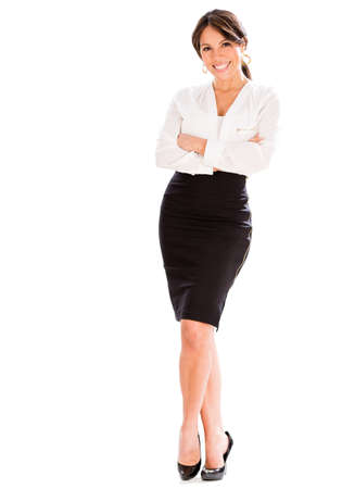 Successful business woman with arms crossed - isolated over white photo