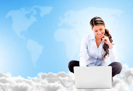Business woman cloud computing looking very happy using wireless technology photo