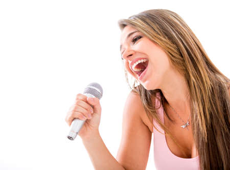 Woman karaoke singing with a microphone - isolated over a white background photo
