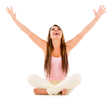 Excited woman with arms open - isolated over a white background photo