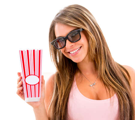 Woman eating popcorn at the movies - isolated over a white background photo