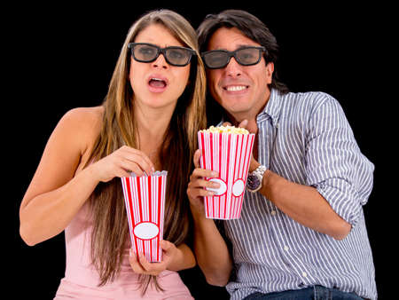 Couple watching a scary 3D movie and wearing glasses photo
