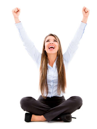 Excited business woman with arms up - isolated over a white background photo
