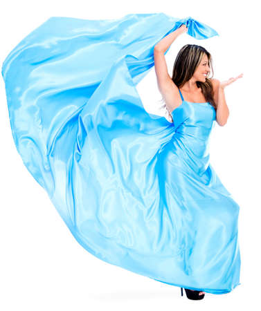 Woman in a beautiful long blue dress - isolated over white background photo