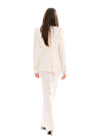 woman walking: Business woman walking away - isolated over a white background Stock Photo