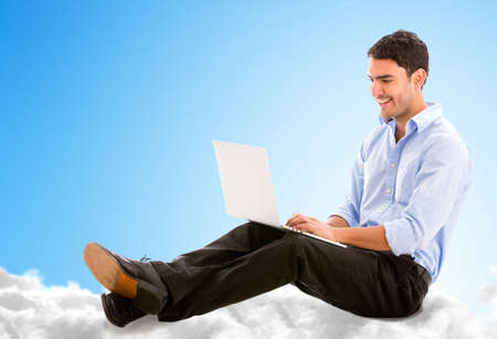 Business man working online from the cloud on his laptop photo