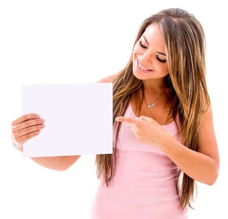 Beautiful woman pointing at a banner - isolated over white background photo