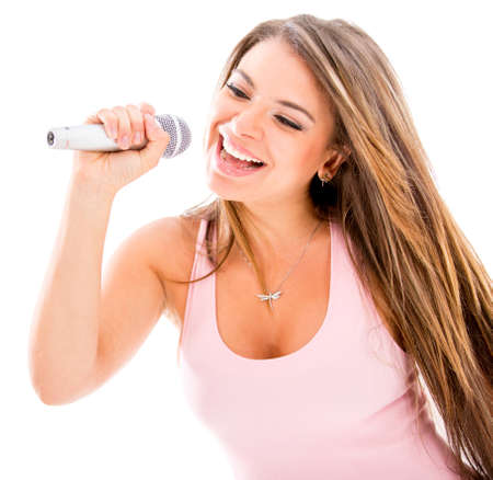 Female singer with a microphone - isolated over a white background photo