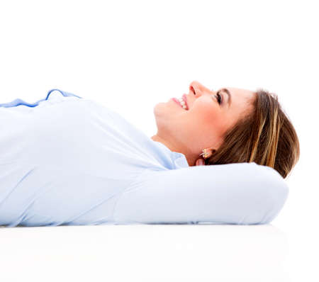 woman looking up: Business woman lying down daydreaming - isolated over white