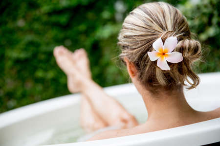 woman in bath: Beautiful woman relaxing at home and taking a bath