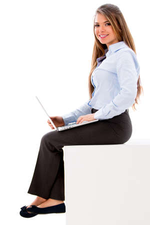 Business woman working on a laptop computer - isolated over white Stock Photo - 19055951