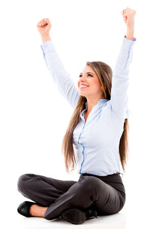 Happy business woman with arms up - isolated over white background photo
