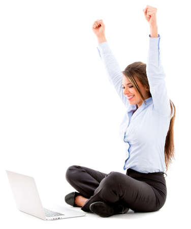 Business woman enjoying her online success - isolated over white photo