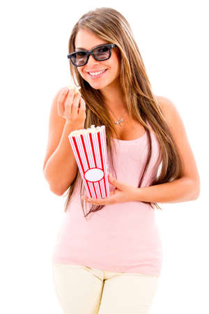Beautiful woman eating popcorn and wearing a 3D movie glasses photo