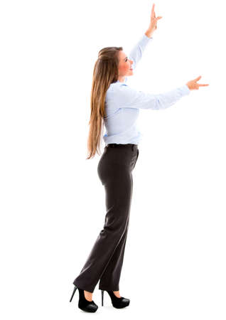 outstretching: Business woman holding an imaginary object up. Isolated over white Stock Photo