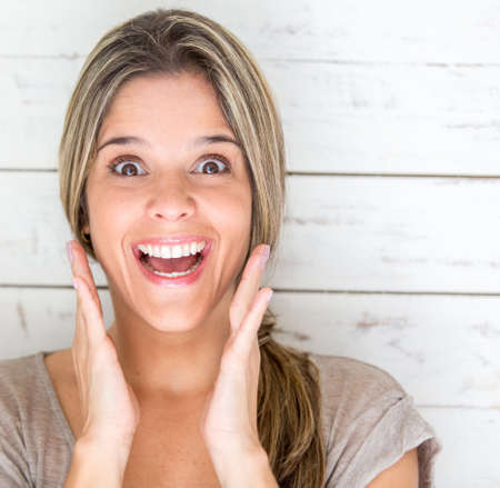 surprised face: Portrait of an excited woman looking surprised