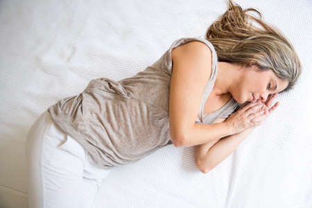 Tired woman sleeping on a bed having sweet dreams Stock Photo - 19151057