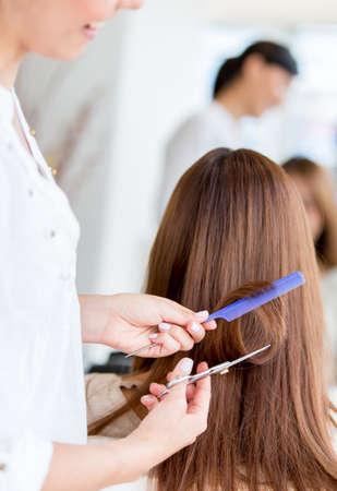 Woman getting a haircut at the beauty salon photo