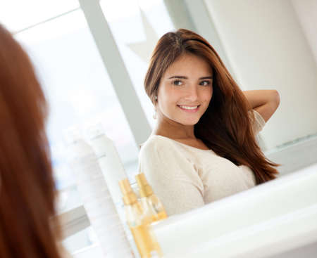 Woman at the beauty salon looking in the mirror Stock Photo - 19160336