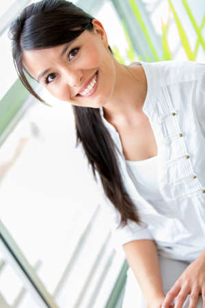 Portrait of a casual woman looking happy and smiling Stock Photo - 19160357