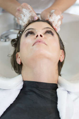Woman getting a hair wash at the beauty salon photo