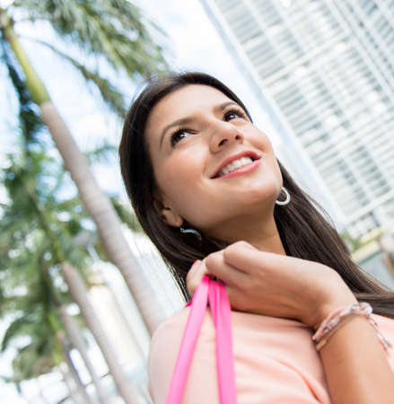 Portrait of a pensive female shopper looking up Stock Photo - 19222984