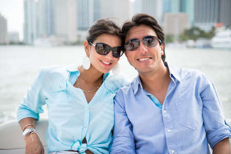 Summer couple in romantic getaway on a yacht photo
