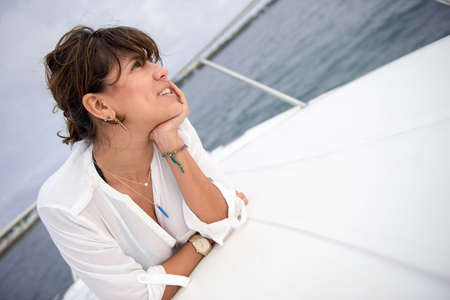 Beautiful thoughtful woman relaxing in a boat photo