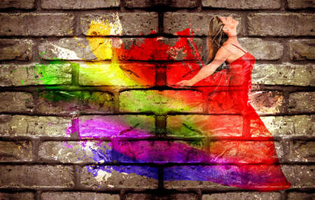 Graffiti of a woman in colorful dress on a brick wall photo
