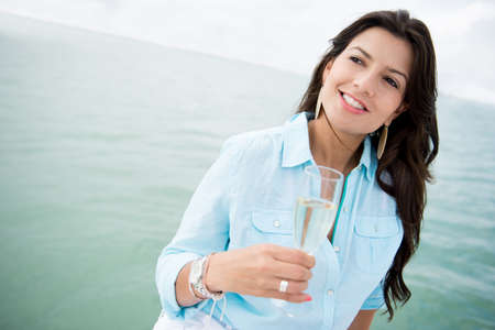 Woman in a boat drinking a glass of champagne Stock Photo - 19226751
