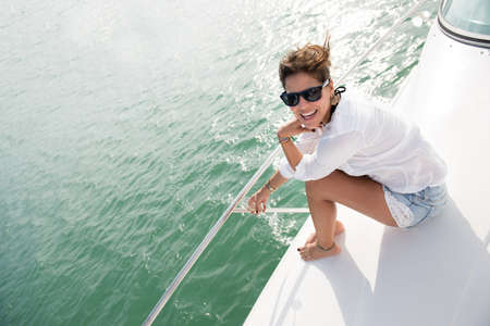 Beautiful woman in a yacht enjoying the summer photo