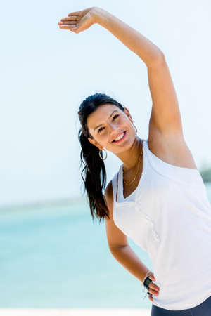 Fit woman exercising outdoors and looking very happy Stock Photo - 19226738