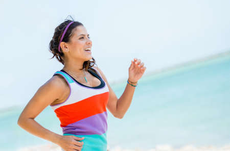 Healthy woman running outdoors looking very happy Stock Photo - 19226737