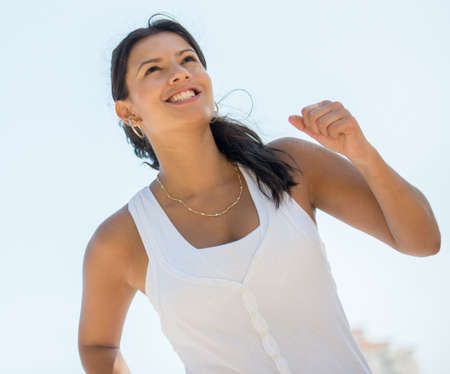 Female runner running outdoors looking very happy Stock Photo - 19226739